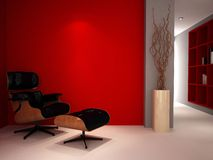 A luxury red study room. A modern classic reading chair in a study lounge painted red Stock Photos