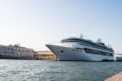 Luxury and relaxing. Sandwich off two photos, one with the ship, and the other one with the fisherman Royalty Free Stock Images