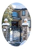 Luxury residential house entrance decorated for Christmass. White round borders