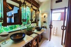 Luxury resort bathroom. Tropical bathroom interior in a luxury resort royalty free stock photography