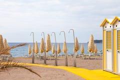 Luxury resort beach with showers in Montenegro, nobody.  Royalty Free Stock Photo