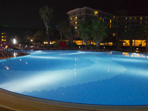 Luxury resort with beautiful pool and illumination night view Royalty Free Stock Images