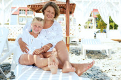 Luxury resort happy family relaxing . Royalty Free Stock Image