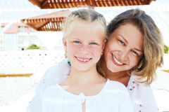 Luxury resort happy family relaxing. Royalty Free Stock Photos