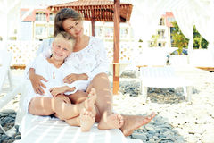 Luxury resort happy family relaxing . Mother and daughter lying down on deckchair of beach resort . Summer vacation idea Royalty Free Stock Image