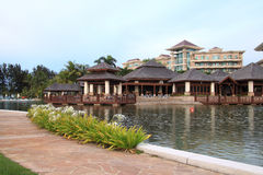 Luxury resort hotel. Luxury tropical resort hotel with a combination of modern and traditional architectural. Footpath is seen alongside the lagoon Royalty Free Stock Photo