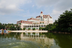 A luxury resort hotel by lake Stock Images
