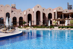 Luxury resort with pool. A luxury swimming pool in a resort Royalty Free Stock Photo