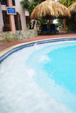 Luxury Resort Pool and hotel garden in Aruba. Royalty Free Stock Photos