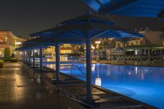 Luxury resort with pool at night view. hotel outdoor landscape with pool. Night pool side of rich hotel.  stock image