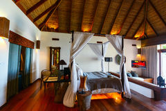 Luxury resort room. Tropical bedroom interior with double bed in a luxury resort royalty free stock photo