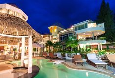 Luxury resort with swimming pool and restaurant at twiligh Royalty Free Stock Photography