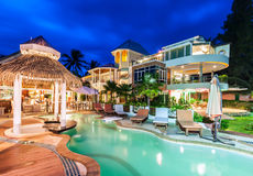 Luxury resort with swimming pool and restaurant at twiligh Stock Image