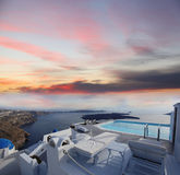 Luxury resort with  swimming pool in Santorini island, Royalty Free Stock Photo