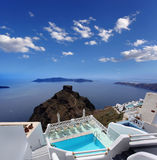 Luxury resort with  swimming pool in Santorini island, Royalty Free Stock Photos