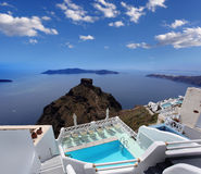 Luxury resort with  swimming pool in Santorini island, Stock Photos