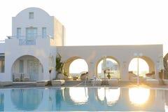 Luxury resort white villas over blue pool water Stock Photos