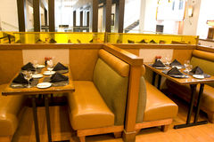 Luxury restaurant with comfortable seatings. Restaurant with comfortable seats and lighting Stock Images