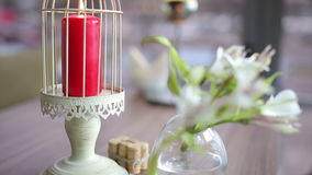 Luxury restaurant interior with Red candle burning on table stock footage