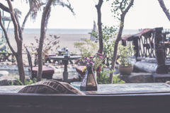 Luxury restaurant by the seaside. Dinner table right. Photographed on Bali island, Indonesia. Royalty Free Stock Images