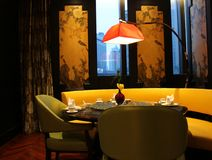 Luxury Restaurant in Shanghai China. Intimate restaurant seating with soft lighting in Shanghai China. Decorative silk screens on the walls Stock Photos