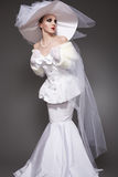 Luxury retro bride. Wedding style, white dress, beautiful hat Stock Image
