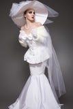 Luxury retro bride. Wedding style, white dress, beautiful hat Stock Image