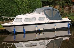 Luxury River Cruiser. A Luxury River Cruiser Boat Moored on a Canal royalty free stock image