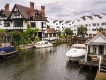 Luxury River Thames Houses. Luxury houses and apartments at Marlow Lock on the River Thames, with boats moored outside. Buckinghamshire, England stock photography