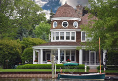 Luxury riverfront house with boat Stock Photo