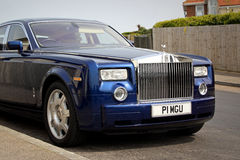 Luxury rolls royce. Photo of a luxury rolls royce in midnight blue colour parked at roadside on a kent street. photo taken 24th april 2015 and ideal for luxury royalty free stock images