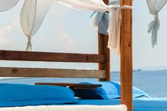 Luxury and romantic bed on the seashore for relaxing holidays/vacations royalty free stock photo