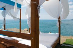 Luxury and romantic bed on the seashore for relaxing holidays royalty free stock images