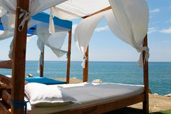 Luxury and romantic bed on the seashore for relaxing holidays stock images