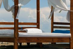 Luxury and romantic bed on the seashore for relaxing time stock photos