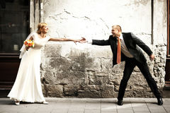 Luxury romantic happy bride and groom celebrating marriage on th Royalty Free Stock Image