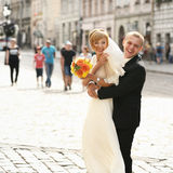 Luxury romantic happy bride and groom celebrating marriage on th Stock Images