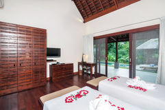 Luxury and Romantic Twin Bedroom Hotel. Beautiful interior and Bedroom villa and Hotel in Bali style property, Indonesia with twin bed and overlooking to the royalty free stock image