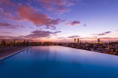Luxury roof top swimming pool with a city view stock photo