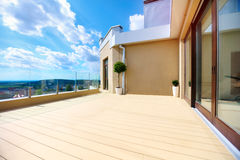 Luxury rooftop terrace with sliding doors. Luxury rooftop terrace with wooden sliding doors Royalty Free Stock Image
