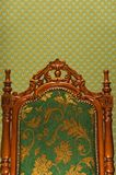 Luxury royal chair. On abstract fabric background Stock Images