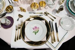 Luxury royal dining set with mani forks and knives on the event in the restaurant. royalty free stock photo
