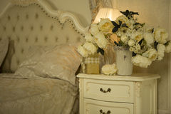 Luxury Royal Interior. Luxurious bed with cushion and stand lamp Royalty Free Stock Photography