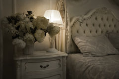 Luxury Royal Interior. Luxurious bed with cushion and stand lamp Stock Photo