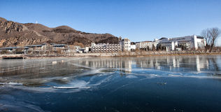 Luxury rustic hotel and ice lake Stock Photo