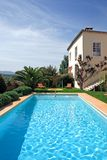 Luxury rustic hotel and swimming pool in countryside stock photos