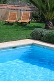 Luxury rustic hotel and swimming pool in countryside Stock Photography
