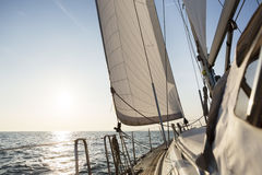 Luxury Sail Boat Sailing In Open Sea During Sunrise Royalty Free Stock Photos