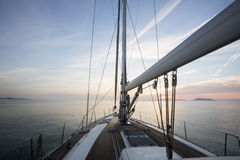 Luxury Sail Boat Sailing In Sea During Sunset Stock Images