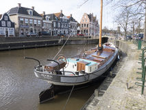 Luxury sailboat moored in the harbor of Dokkum. Royalty Free Stock Image
